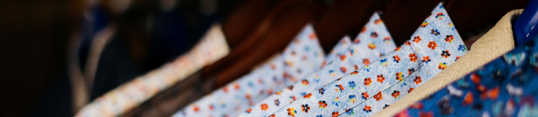 A rack of fun and vibrant dress shirts from designer brands.