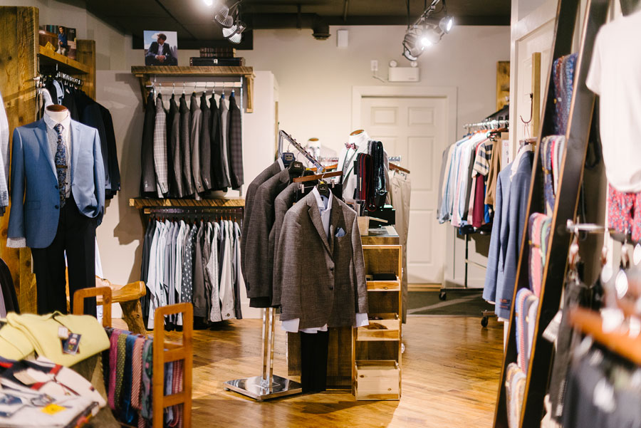 The suit section of Taylor and Co, at the back of the store.